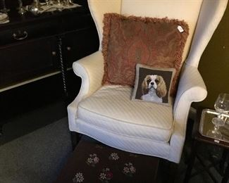 Great wingback chair with an antique needlepoint ottoman