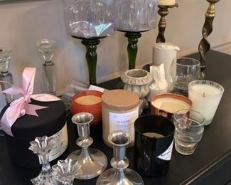 assortment of candles and candle holders