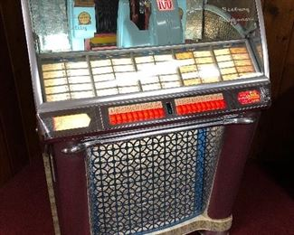 Vintage Seeburg Select O Matic 100 vintage juke box.  Needs servicing, lights up but does not play music.