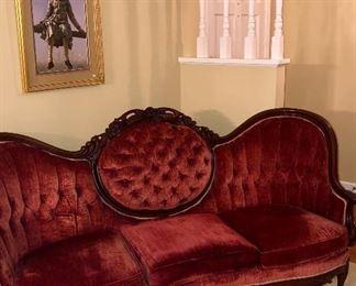 Antique Rosewood velvet sofa with three cushion medallion back and framed art.