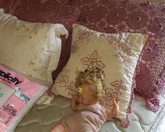 bed, mattresses, pillows, doll