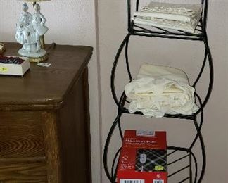 black iron shelves with linens