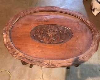 Carved inlay table with glass top