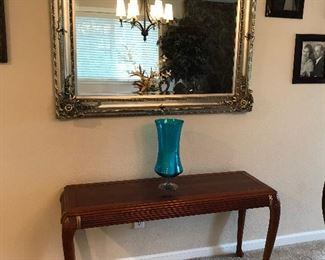Large gold framed wall mirror w/sofa/entry table