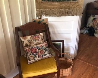 the matching chair to the settee. both in great shape. a good looking tapestry hangs on the door. check out the split oak basket and the rabbit ready to hop home with you.
