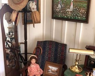 a great corner as you enter the home. a vintage hat rack next to original art.  an old Shirley Temple doll sits next to small original art pieces in rustic frames. check out every nook and cranny as they will be filled with items