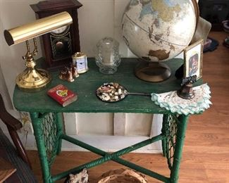 love this painted green old wood table with wicker sides. farm house green.  lots of items to choose from in this sale.  old tobacco cans. a good looking globe and so much more.