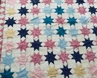 a beautiful hand pieced star quilt. very good condition. clean and ready to be part of your world