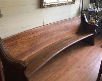 now this antique is a beauty. a curved hand made church pew. beautiful wood. very nice condition