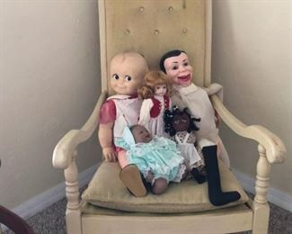 Antique rocker with assorted old dolls