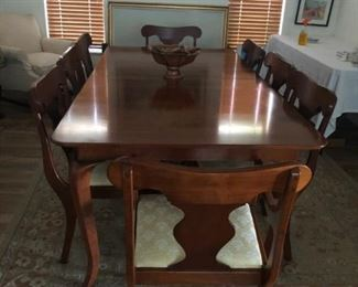 Magnificent eight chair Queen Anne style dining set with two leaves in near perfect condition.
