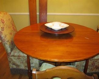 table with lazy susan and leafs