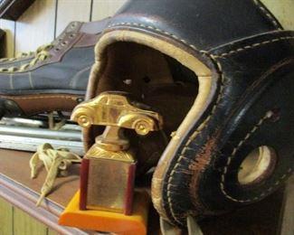 leather helmet & racing trophy