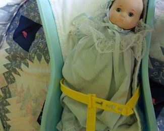 BABY DOLL IN CARRIER
