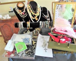 TABLES FILLED WITH COSTUME JEWELRY