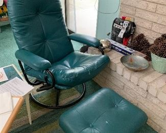 teal swivel rock and ottoman