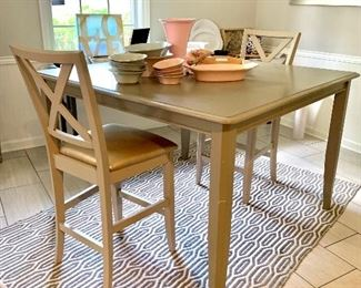 Fresh painted table and chair set Cool rug Fun artwork