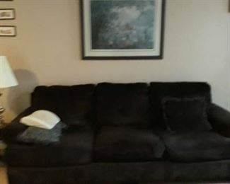 brown couch and room size rug and painting on wall are all for sale.