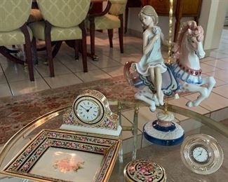 The Lladro girl on the carousel is sold. The Wedgewood trinket box and the rectangular tray are also sold.