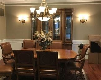 Bernhardt formal dining set, six side chairs, two arm chairs beautifully carved with leather seats and accents, with China cabinet, side server/buffet, Two leaves, and custom made Table top protectors.