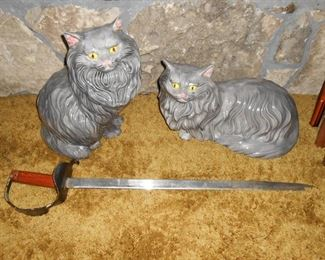 Peaceful ceramic  cats.....and a sword