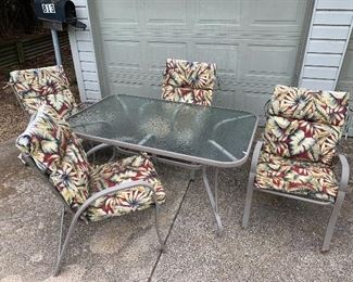 Glass top table and 4 chairs with cushions  3'x5' Table.