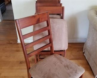 more new folding dining room chairs. These have micro-fiber fabric seats. wood frames