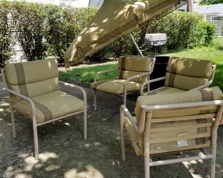 Outdoor umbrella & 4 chairs w/cushions. umbrella needs extension pipe and stand