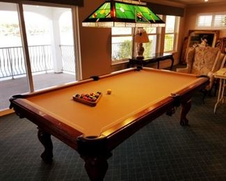 8-ft table.  Includes balls and cue sticks.