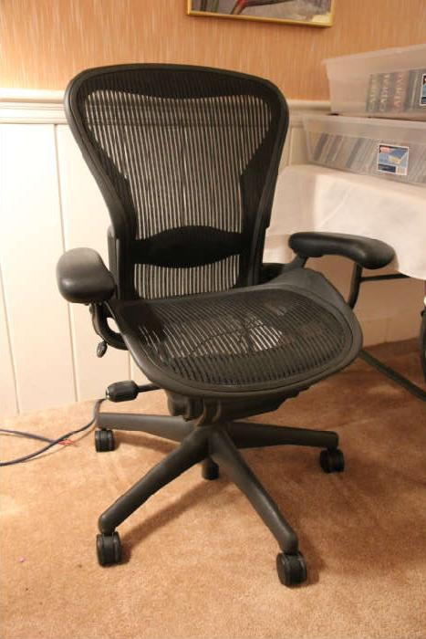 There are two Herman Miller Aeron chairs.