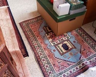 Um, rugs again. Table showing at left is sold.
