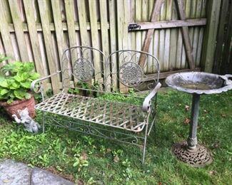Garden bench and bird baths.