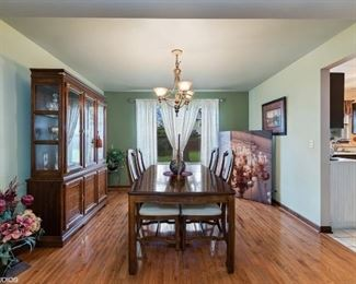 Dining table and chairs, china cabinet and floral arrangement on floor are FOR sale