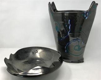 Pair of Black Pottery Vessels           https://ctbids.com/#!/description/share/178960
