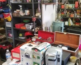 Garage stuffed with all types of tools, plumbing supplies, andceverything else