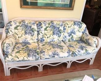 Wicker Sofa with Floral Cushions
