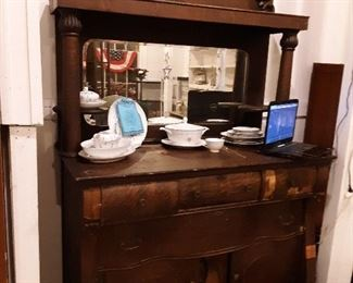 The most stunning piece in building!  Late 1800s, made by SC furniture maker who enjoyed carving toenails on the claw foot bases!  Dont let the need for a little veneer work make you pass this one up!