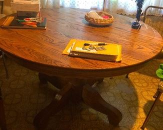 big round oak dining table