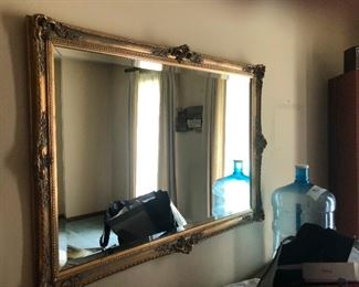 a large mirror that is definitely not reflecting a ghost