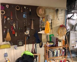 More pegboards! Hanging from it are implements of everyday craft you need this!