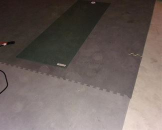 Rubber workout matting.