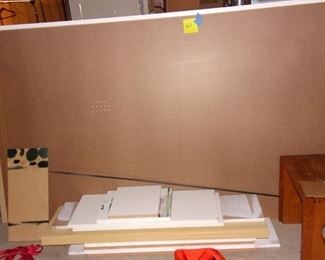 Large peg board and wood pieces.