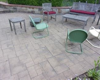 Teak patio set (table and chairs, love seat/bench, two arm chairs, 2 end tables and coffee table) and vintage metal rocker chairs (3).