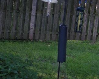 Many bird feeders.