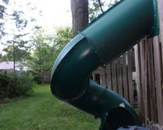 Covered slide from a play area. Sold separately.