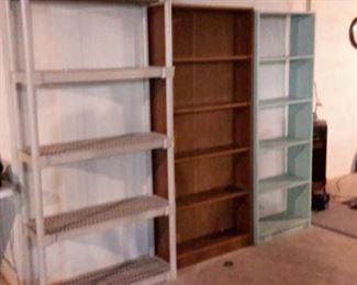 Two wood bookshelves and one plastic garage shelf.