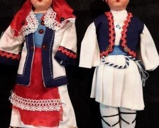 Antique bisque head and fabric body dolls.