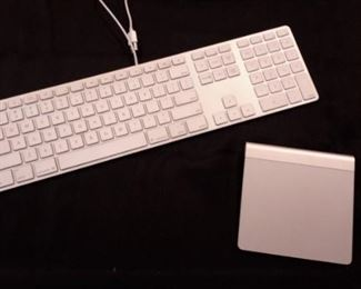Apple wired keyboard A1243 and Apple wireless Magic trackpad. A1339