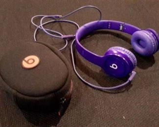 Beats headphones, purple, with case.