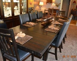 """94"""" Trestle Table with 8 chairs +(2) 16"""" leaves- almost new"""